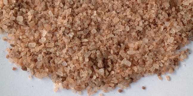 Redmond Natural Trace Mineral Salt is pink, tan, white, and grey in color.  Buy Redmond salt for your livestock animals!